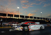 Sept. 28, 2012; Madison, IL, USA: NHRA pro stock driver Greg Stanfield (near lane) races alongside V. Gaines during qualifying for the Midwest Nationals at Gateway Motorsports Park. Mandatory Credit: Mark J. Rebilas-