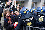 Delegates and members of Civil Society clash with the police after leaving the Bella Center. They are trying to join the larger crowd outside but are beaten back and prevented from doing so by Danish police.  (Images provided for editorial web usage for members of the Fresh Air Center during COP 15. Credit: Robert vanWaarden)