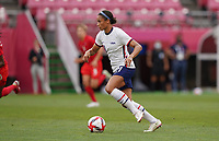 KASHIMA, JAPAN - AUGUST 2: Lynn Williams #21 of the United States with the ball during a game between Canada and USWNT at Kashima Soccer Stadium on August 2, 2021 in Kashima, Japan.