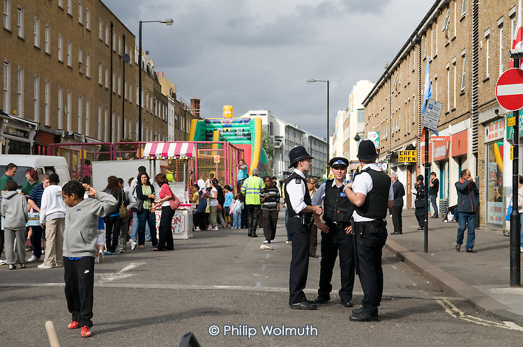 Police on duty at the annual summer festival in Church Street, London.