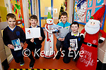 Lisselton NS students Odhran Barrett, Shay Fennell, Finan Mason and Eoghan Horgan who wrote Christmas cards to the people in Ballydonoghue.