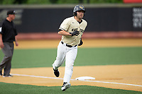 Logan Harvey (15) of the Wake Forest Demon Deacons rounds third base during the game against the Miami Hurricanes at David F. Couch Ballpark on May 11, 2019 in  Winston-Salem, North Carolina. The Hurricanes defeated the Demon Deacons 8-4. (Brian Westerholt/Four Seam Images)