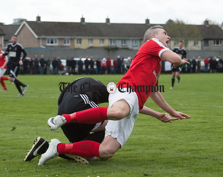 Eoin Hayes of Newmarket Celtic is taken down by Shane Clarke of Janesboro during their Munster Junior Cup semi-final at Limerick. Photograph by John Kelly.