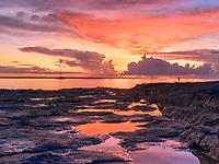 A lone fisherman at sunset