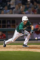 Hunter Jones (33) of the Charlotte 49ers lays down a bunt against the Georgia Bulldogs at BB&T Ballpark on March 8, 2016 in Charlotte, North Carolina. The 49ers defeated the Bulldogs 15-4. (Brian Westerholt/Four Seam Images)