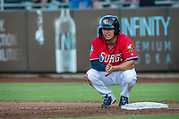 Wichita Wind Surge outfielder Ernie De La Trinidad (15) sits at first base after a play against the Northwest Arkansas Naturals at Riverfront Stadium on July 9, 2021 in Wichita, Kansas. (William Purnell/Four Seam Images)