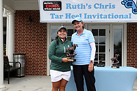 CHAPEL HILL, NC - OCTOBER 13: Valery Plata of Michigan State University is presented a trophy for the best individual score by head coach Jan Mann of the University of North Carolina at UNC Finley Golf Course on October 13, 2019 in Chapel Hill, North Carolina.
