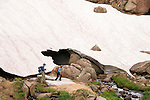 couple hiking, (MR), hike, subalpine, snow bank, stream, high elevation, recreation, outdoors, activity, adventure, back country, August, afternoon, Rocky Mountain National Park, Colorado, USA