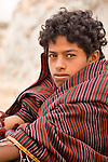 Portrait of a young bedouin boy, Jabal Samhan, Oman.