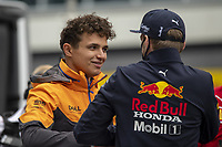 26th September 2021; Sochi, Russia; F1 Grand Prix of Russia, Race Day: Lano Norris chat with Max Verstappen about the rain at the end of the race that took Norris from 1st place to 6th place at the end