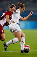 Amy Rodriguez. The USWNT defeated Canada in extra time, 2-1, during the 2008 Beijing Olympics in Shanghai, China.