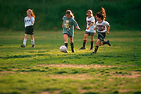 Girls playing soccer.