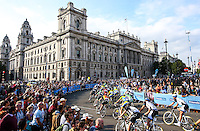 Picture by Alex Whitehead/SWpix.com - 14/09/2014 - Cycling - 2014 Friends Life Tour of Britain - Stage 8b, London Circuit Race - The peloton ride past the HMRC building during Stage 8b in London.