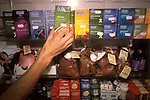 Man buying a packet of Durex condoms and sexual items on display in a sex shop. Harmony sex shop London England 2000s UK
