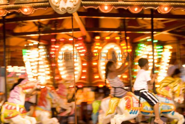 Children Riding a Carousel Ride, Coney Island, New York City, New York State, USA