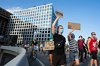 Demonstrators march to Interstate 395 in Washington D.C., U.S., on Tuesday, June 23, 2020.  Trump tweeted that he authorized the Federal government to arrest any demonstrator caught vandalizing U.S. monuments, with a punishment of up to 10 years in prison.  Credit: Stefani Reynolds / CNP/AdMedia