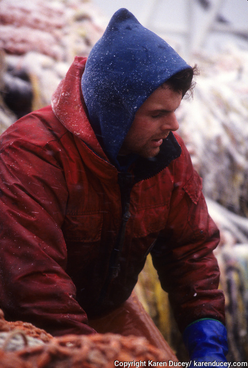 Deckhand Todd kean, works on the F/V Auriga, a dragger, also known as a trawler, fishes for pollock in the Bering Sea.