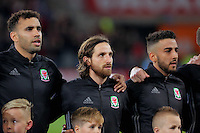 (L-R) Hal Robson-Kanu, Joe Allen and Neil Taylor of Wales sing the national anthem during the 2018 FIFA World Cup Qualifier between Wales and Serbia at the Cardiff City Stadium, Wales, UK. Saturday 12 November 2016