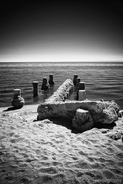 Black and white image of old pier pilings Bombay Beach, Salton Sea, CA