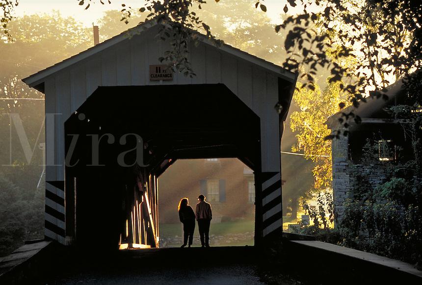 Couple strolling through a covered bridge. Couple. Strasburg Pennsylvania USA Lancaster County.