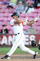 Salem-Keizer outfielder Chuckie Jones #20 bats against the Eugene Emeralds at Volcanoes Stadium on August 9, 2011 in Salem-Keizer,Oregon. Eugene defeated Salem-Keizer 13-7.(Larry Goren/Four Seam Images)