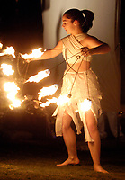 Lindsay Johannessen (CQed), of Elemental Artistry, performs with fire, after a Parade of Little Angels Saturday night. The event was part of All Souls Procession festivities and took place at the downtown main library, 100 North Stone Ave.