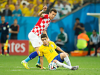 Oscar of Brazil takes on Ivan Perisic of Croatia