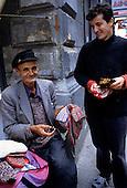 Sarajevo, Bosnia. Old man selling hand knitted woolen socks.