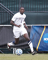 University of Connecticut forward Stephane Diop (5) dribbles down the wing..NCAA Tournament. Creighton University (blue) defeated University of Connecticut (white), 1-0, at Morrone Stadium at University of Connecticut on December 2, 2012.