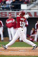 Justin Smoak (12) of the South Carolina Gamecocks follows through on his swing versus the East Carolina Pirates at Sarge Frye Field in Columbia, SC, Sunday, February 24, 2008.