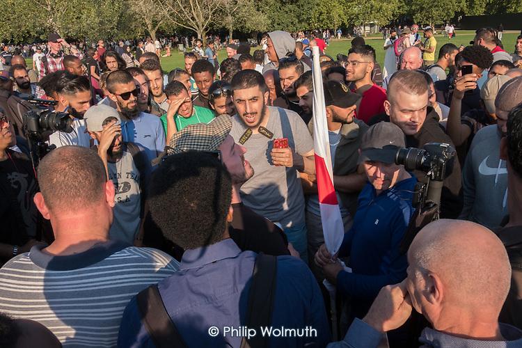 Regular Muslim debater Ali Dawah  argues with  Tommy Robinson supporters, Speakers' Corner, Hyde Park, London.