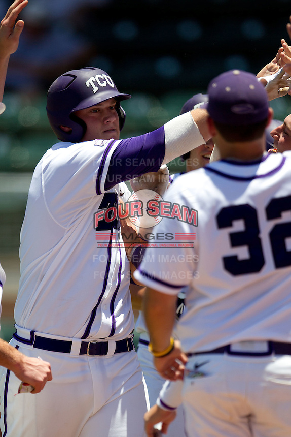 Designated Hitter Kevin Cron #00 of the Texas Christian University Horned Frogs is greeted by his teammates after he homered during the NCAA Regional baseball game against the Ole Miss Rebels on June 1, 2012 at Blue Bell Park in College Station, Texas. Ole Miss defeated TCU 6-2. (Andrew Woolley/Four Seam Images).