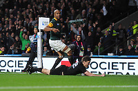 Beauden Barrett of New Zealand scores a try in the corner as JP Pietersen of South Africa can only watch during the Semi Final of the Rugby World Cup 2015 between South Africa and New Zealand - 24/10/2015 - Twickenham Stadium, London<br /> Mandatory Credit: Rob Munro/Stewart Communications