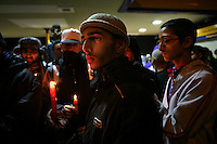 Anger and sadness among young Asian men at a vigil, the night after the killing of three men: 21 year old Haroon Jahan, and brothers Shazad Ali (30) and Abdul Musavir (31) who were killed on Tuesday evening in a hit and run incident by suspected looters as they guarded a petrol station forecourt with many other people on Dudley Road in the Winson Green area of Birmingham, which was hit by a surge of rioting and looting. The violence started in London on Saturday evening after a peaceful protest in response to the shooting by police of Mark Duggan during an attempted arrest escalated into a riot, but has now spread to other areas in the country.