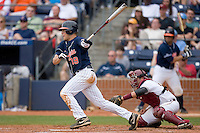 Steven Proscia #19 of the Virginia Cavaliers follows through on his swing versus the Florida State Seminoles at Durham Bulls Athletic Park May 24, 2009 in Durham, North Carolina. The Virginia Cavaliers defeated the Florida State Seminoles 6-3 to win the 2009 ACC Baseball Championship.  (Photo by Brian Westerholt / Four Seam Images)