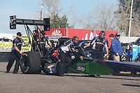Feb. 22, 2013; Chandler, AZ, USA; NHRA crew members for top fuel dragster driver Leah Pruett during qualifying for the Arizona Nationals at Firebird International Raceway. Mandatory Credit: Mark J. Rebilas-