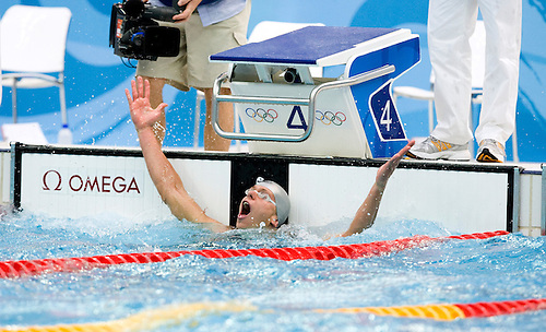16 AUG 2008 - BEIJING, CHN - Cesar Cielo Filho (BRA) celebrates winning the Men's 50m freestyle final in an new Olympic record time of  21.30 seconds - Beijing Olympics. (PHOTO (C) NIGEL FARROW) *** IOC RULES APPLY ON USAGE ***