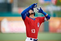 Buffalo Bisons shortstop Lourdes Gurriel Jr. (13) points skyward as he crosses home plate after hitting a grand slam home run in the bottom of the fourth inning during a game against the Scranton/Wilkes-Barre RailRiders on May 18, 2018 at Coca-Cola Field in Buffalo, New York.  Buffalo defeated Scranton/Wilkes-Barre 5-1.  (Mike Janes/Four Seam Images)