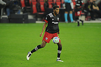 WASHINGTON, DC - OCTOBER 28: Donovan Pines #23 of D.C. United moves the ball during a game between Columbus Crew and D.C. United at Audi Field on October 28, 2020 in Washington, DC.