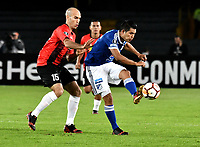 BOGOTA - COLOMBIA – 17 - 04 - 2018: David Silva (Der.) jugador de Millonarios (COL), disputa el balon con Ricardo Andreutti (Izq.) jugador de Deportivo Lara (VEN), durante partido entre Millonarios (COL) y Deportivo Lara (VEN), de la fase de grupos, grupo G, fecha 3 de la Copa Conmebol Libertadores 2018, en el estadio Nemesio Camacho El Campin, de la ciudad de Bogota. / David Silva (R) player of Millonarios (COL), figths for the ball with Ricardo Andreutti (L) player of Deportivo Lara (VEN), during a match between Millonarios (COL) and Deportivo Lara (VEN), of the group stage, group G, 3rd date for the Conmebol Copa Libertadores 2018 in the Nemesio Camacho El Campin stadium in Bogota city. VizzorImage / Luis Ramirez / Staff.