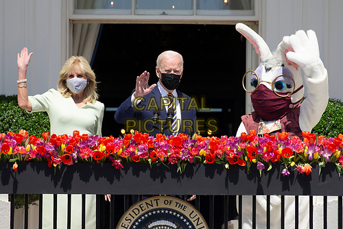US President Joe Biden (C) waves beside First Lady Jill Biden (L) and the Easter bunny while delivering remarks regarding Easter, on the Truman Balcony at the South Lawn of the White House, in Washington, DC, USA, 05 April 2021. The traditional Easter Egg Roll at the White House with thousands of visitors was not held due to the coronavirus COVID-19 pandemic.<br /> CAP/MPI/RS<br /> ©RS/MPI/Capital Pictures