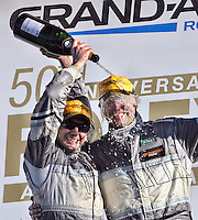 Andy Lally ,left, and John Potter celebrate with champagne after their GT class win in the Rolex 24 at Daytona, Daytona International Speedway, Daytona Beach, FL, January 2011.  (Photo by Brian Cleary/www.bcpix.com)