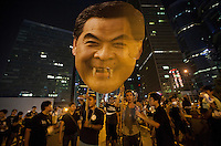 Occupy Central pro-democracy protesters hold up a giant effigy of Hong Kong Chief Executive Leung Chun-ying's head, whom they are calling on to resign, on the second day of the mass civil disobedience campaign Occupy Central, Central District, Hong Kong, China, 30 September 2014. The movement is also being dubbed the 'umbrella revolution' after the versatile umbrellas used to shield protesters from rain, sun - and police pepper spray.