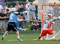 Johns Hopkins (92) shoots a goal past Virginia Cavaliers goalie (18) during the game in Charlottesville, VA. Johns Hopkins defeated Virginia 11-10 in overtime. Photo/Andrew Shurtleff