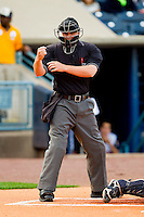 Home plate umpire Jeff Gosney makes a strike call during the International League game between the Charlotte Knights and the Toledo Mudhens at 5/3 Field on May 3, 2013 in Toledo, Ohio.  The Knights defeated the Mudhens 10-2.  (Brian Westerholt/Four Seam Images)