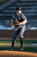 Cincinnati Bearcats starting pitcher Matt Ring (21) delivers a pitch to the plate against the Wake Forest Demon Deacons at Wake Forest Baseball Park on February 21, 2014 in Winston-Salem, North Carolina.  The Bearcats defeated the Demon Deacons 5-0.  (Brian Westerholt/Four Seam Images)