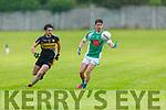 Darragh Carmody of Na Gaeil controls the ball as Niall Brosnan of Currow keeps and eye on him, in the Intermediate Club Championship