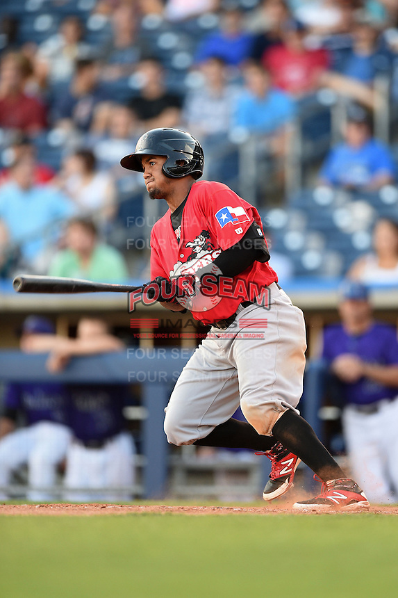 Frisco Rough Riders outfielder Teodoro Martinez (28) at bat during the second game of a doubleheader against the Tulsa Drillers on May 29, 2014 at ONEOK Field in Tulsa, Oklahoma.  Frisco defeated Tulsa 3-2.  (Mike Janes/Four Seam Images)