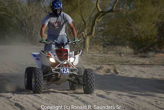 MAN on ATV RIDES THROUGH DESERT DURING TECATE's ANNUAL 250 SCORE OFF-ROAD RACE
