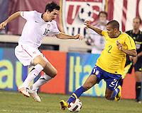 Sacha Kljestan #16 of the USA twists away from Dani Alves #2 of Brazil during an international friendly match in Giants Stadium, on August 10 2010, in East Rutherford, New Jersey. brazil won 2-0.